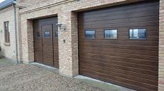 Какие ворота для гаража выбрать, секционные или распашные: типы и характеристики